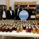 The 2016 Community Can donation was almost 400 jars in Fort St John. North Peace Savings and Credit Union staff along with NEAT Executive Director Dzengo Mzengeza present the 2016 Community Can donation to Sheldon Feener of the Fort St John Salvation Army.